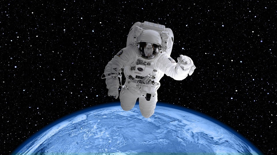 Astronaut with an aerial view of the Earth in the background