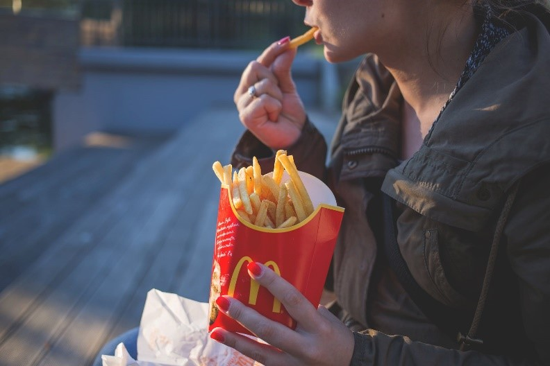 Photo of a person eating fast food