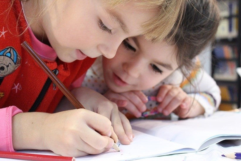 Two children working on a written task