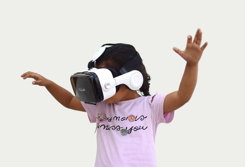 A child wearing a VR headset