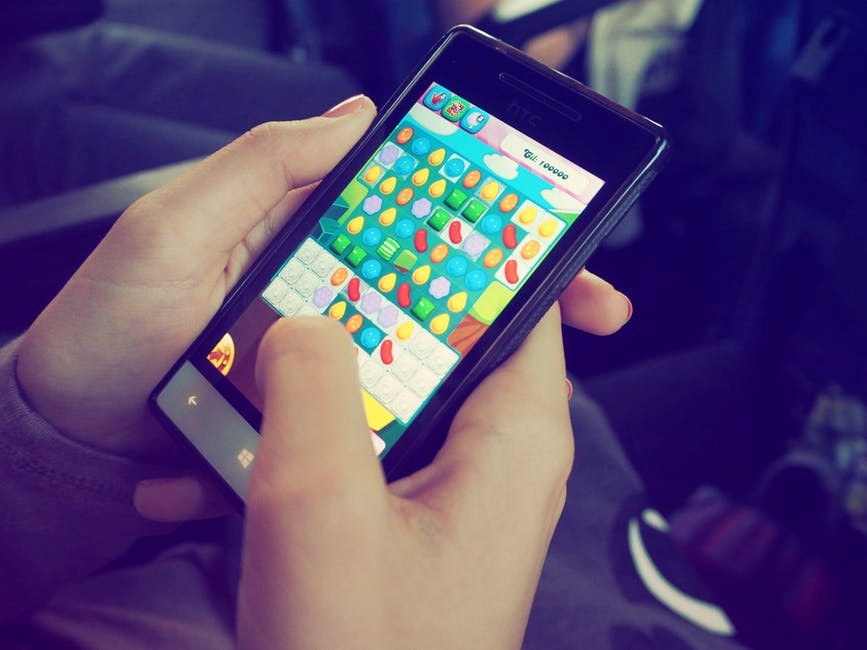 Playing Candy Crush on a smart phone