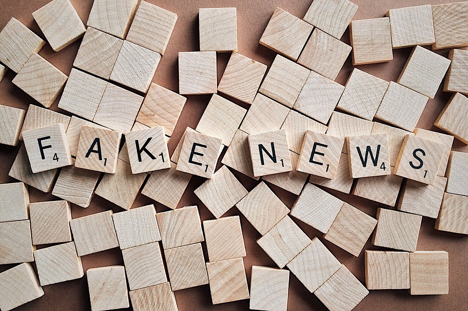 Fake news written on scrabble-style wooden pieces