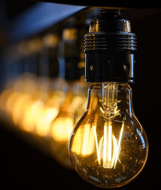 Image of a line of light bulbs one if front of the other
