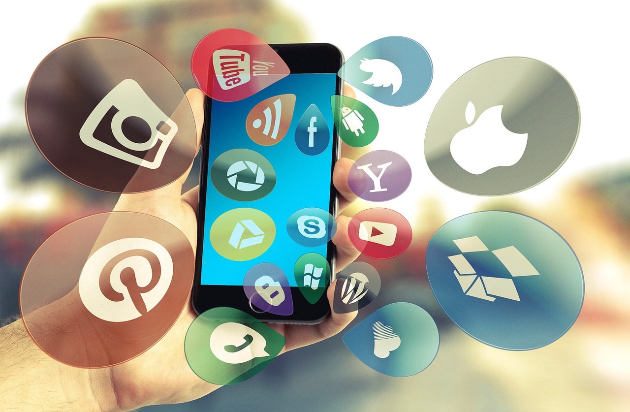 Image of a phone and social media icons