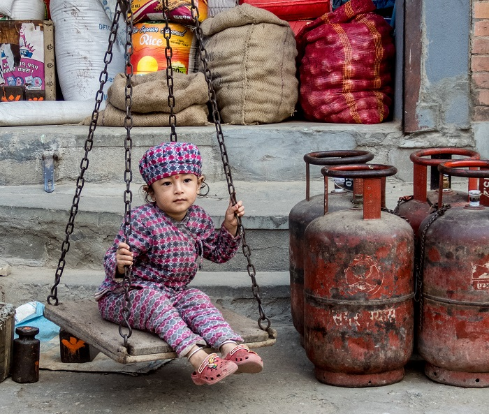 A child plays in a marketplace in Kathmandu, Nepal