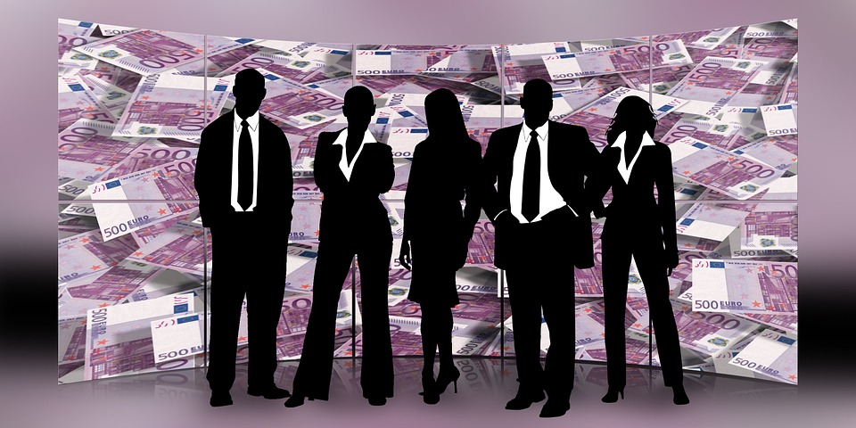 Five business people silhouettes in front of a backdrop of Euro notes.