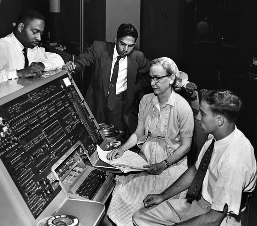 US Navy Read Admiral Grace Hopper working on an early computer