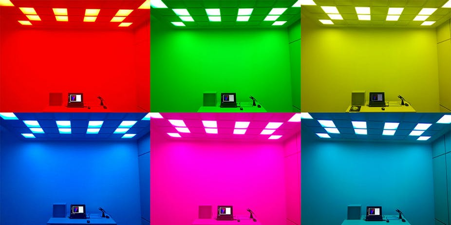 The same room but lit up in six different colours.