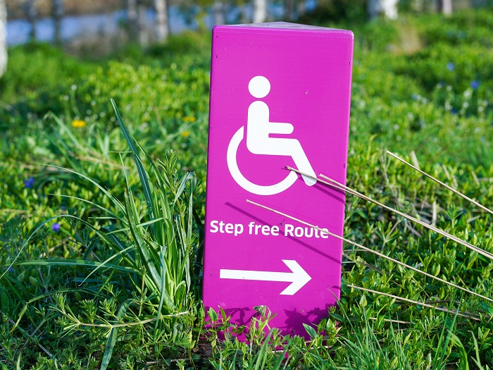 "A sign with the wheelchair user symbol reads ""Step free Route"""